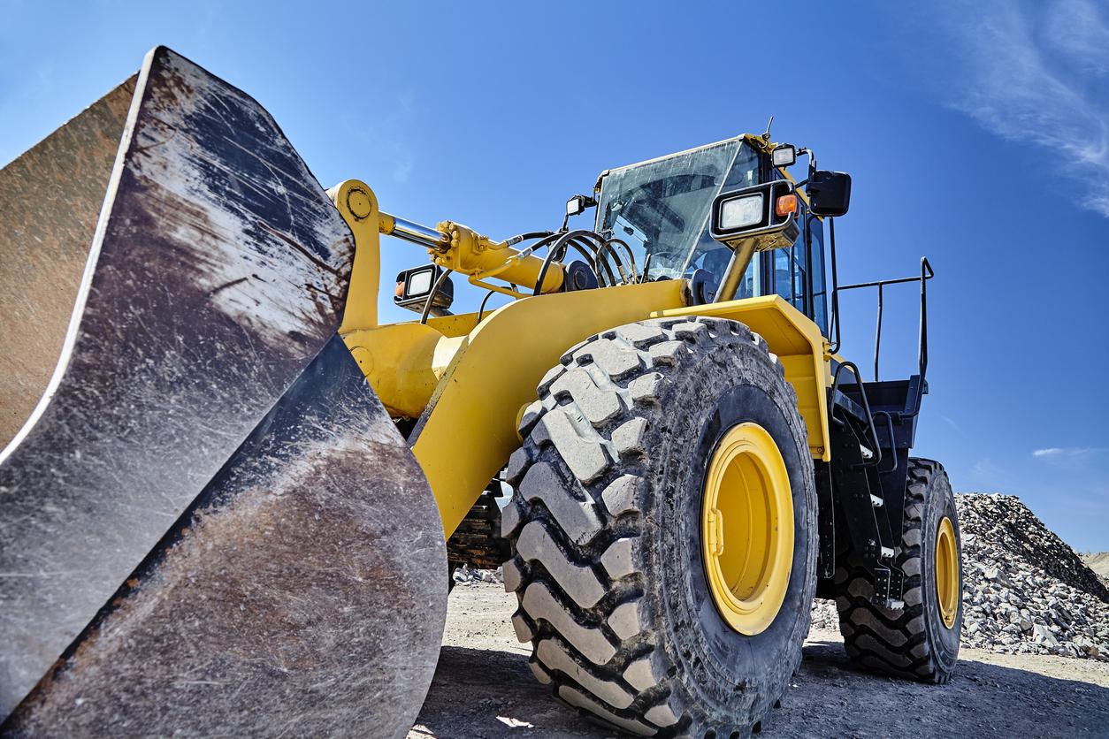 Construction heavy equipment loader and bucket on jobsite